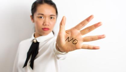 Word No written on businesswoman hand