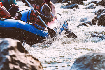 Close-up of young person rafting on the river, extreme and fun sport at tourist attraction Wall mural