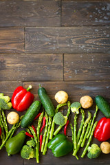 Food background. Variety vegetables. Top view of group vegan product - pepper, avocado, broccoli, cucumber, lime,potato,asparagus,tomato. Healthy eating concept. Copy space