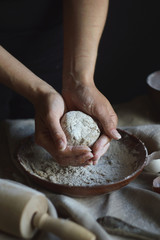 Women's hands are preparing home-made raw noodles, Rustic, Selective Focus, Atmospheric dark tone