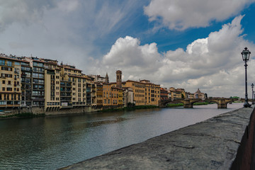Horizontal composition of the River Arno in Florence  with dramatic clouds.