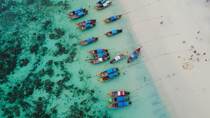 Aerial view over group of long tail boats with beautiful sea and beach,Top view from drone, Koh Lipe island, Satun,Thailand.