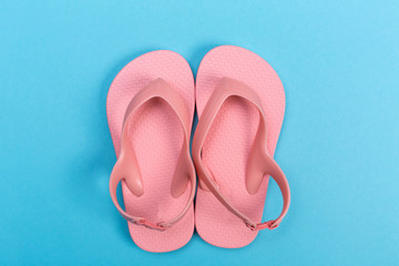 Beach sandals on a blue background