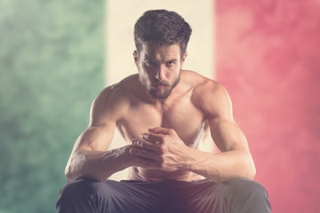 Muscular man with Mexico Flag behind