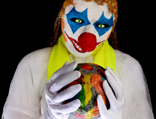 Clown wearing a mask and wearing white clothes