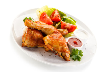 Roast chicken legs on white background
