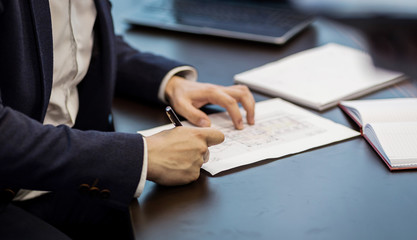 Close up businessman signing documents.Businessman is signing a contract,Man signing a document or writing correspondence