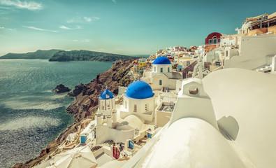 Santorini blue dome churches on the steep cliff, Greece. Caldera view.