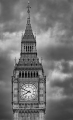 Close up of the clock face of Big Ben in Westminster, London on a cloudy day. Black and white picture with dramatic sky.