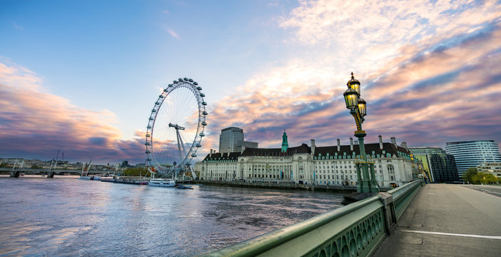 South Bank of the River Thames at sunrise in London, England.