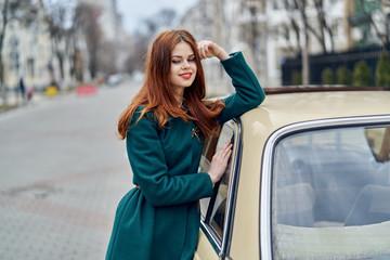 1033339 Woman driving a retro car, young woman driving a car