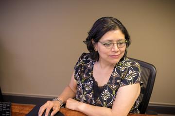 Gen-X Woman Working At Desk