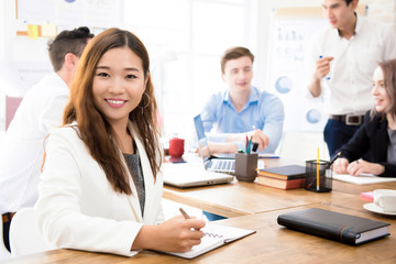 Smiling young confident Asian businesswoman at the office