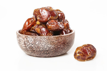 Dried dates in small bowl - studio shoot on the white