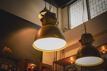 Modern and vintage fashion lamp Edison interior loft room. Lantern with filament