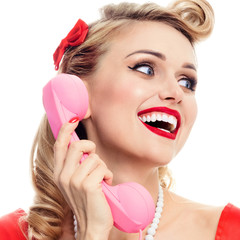 woman with money, talking on phone, dressed in pin-up style dress