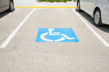 Logos for disabled on parking. handicap parking place sign in boston city.