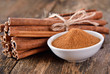 Cinnamon powder in a bowl on table wooden