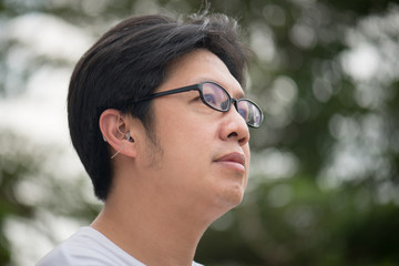 man with hearing aid behind the ear