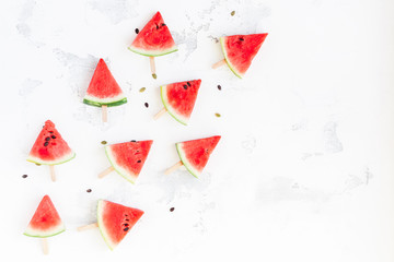 Watermelon popsicle. Sliced watermelon on white background. Flat lay, top view
