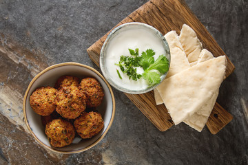 Middle Eastern traditional dishes. Falafel with sour cream. Vegetarian food.