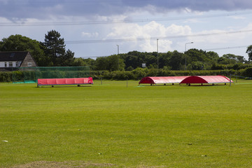 The village cricket ground in Titchfield Common in Hampshire with covers in place in readiness for the weekend match