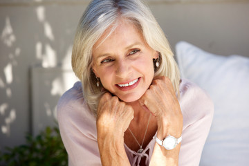 Close up mature lady smiling outside