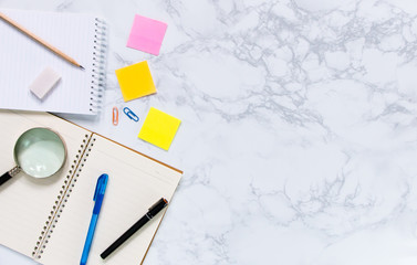 Modern flat lay of stationery on white marble texture background - Work space desk concept.