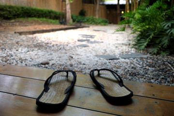 Japanese traditional sandals with the background of garden