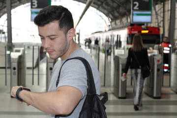Man looking at his watch in the train station