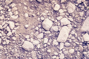 Background from a gravel road. Texture of pebbles and ground.