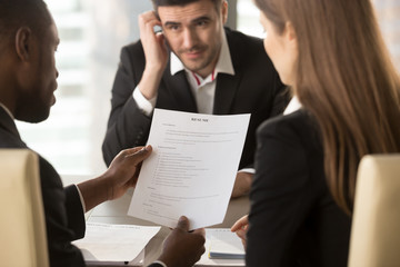 Employers or recruiters holding reviewing bad poor cv of unemployed worried nervous applicant waiting for result, employment and recruitment concept, rejected job application, failed interview, close