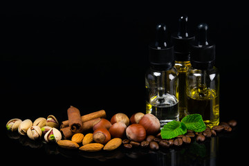 Flavored oils in bubbles surrounded by nuts, cinnamon and fresh mint