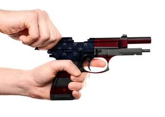 Man's hands reloading gun on white background