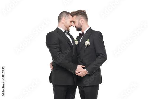 Gay men in suits kissing