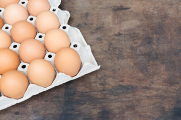 Chicken egg on wooden background with copy space