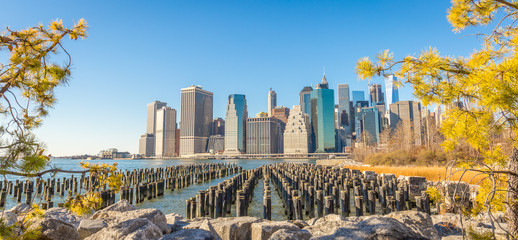 Old Pier Pylons and Downtown Manhattan, Panoramic View from the Brooklyn, New York City, Sunny Day