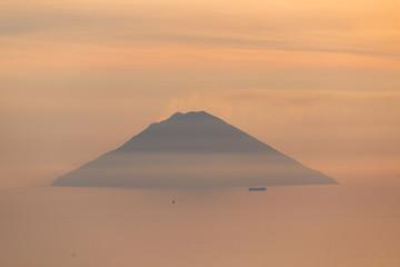 Volcano Stromboli view at sunrise sunset from Salina Eolian island in summer