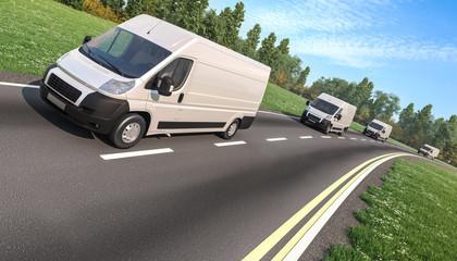 Several Delivery Vans on the Asphalt Road