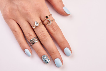 Wall Mural - Beautiful manicure with jewelry close up.