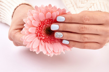 Wall Mural - Beautiful manicure and flower.