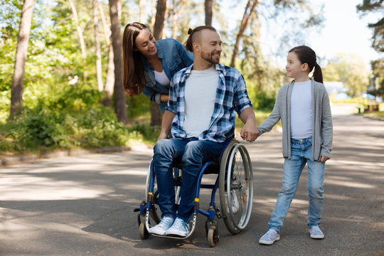 Positive delighted family going for a walk