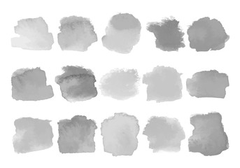 Set of gray watercolor stains on white