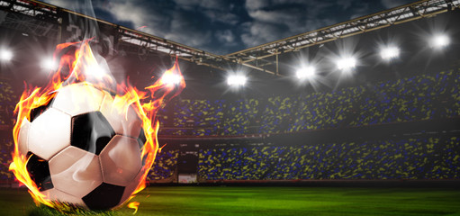 Soccer or football ball on fire at stadium
