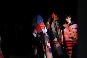 Models present creations at the Craig Green catwalk show at London Fashion Week Men's in London