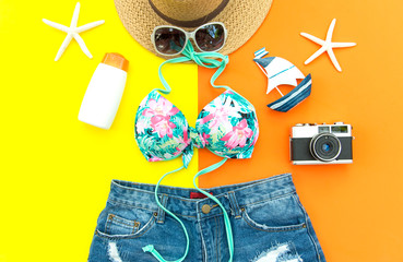 Summer Fashion woman swimsuit Bikini. Tropical sea.Unusual top view.Vacation concept, background colorful