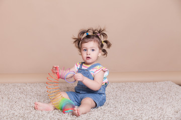 funny girl with pigtails in summer