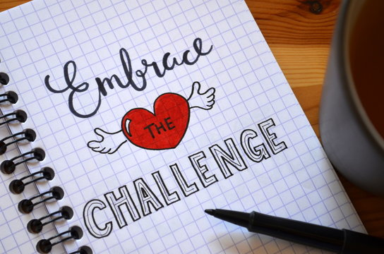 EMBRACE THE CHALLENGE hand lettered in notebook