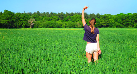 Young Caucasian White Woman in Barley Farm Field on a Sunny Blue Sky Day, England, UK