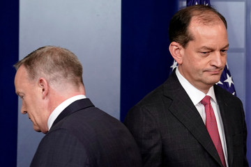 Secretary of Labor Alex Acosta walks by White House Press Secretary Sean Spicer as he arrives to speaks during the daily briefing at the White House in Washington, U.S.